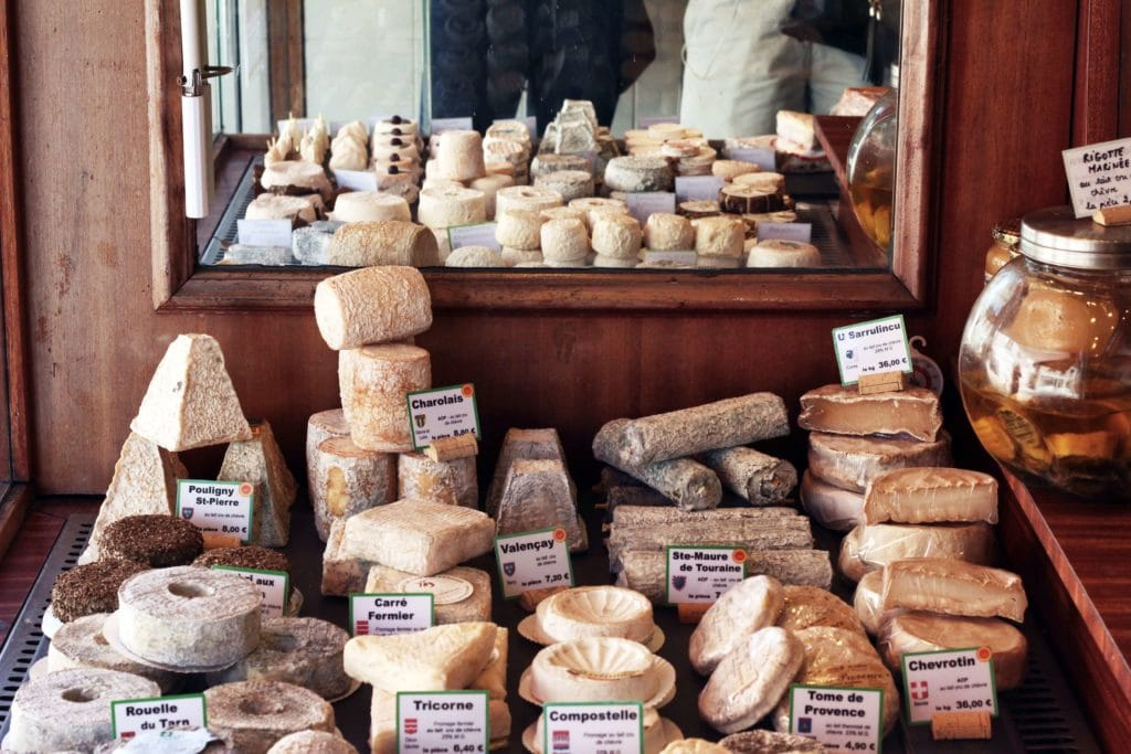 French Cheese Display - Photo by Elisa Michelet on Unsplash