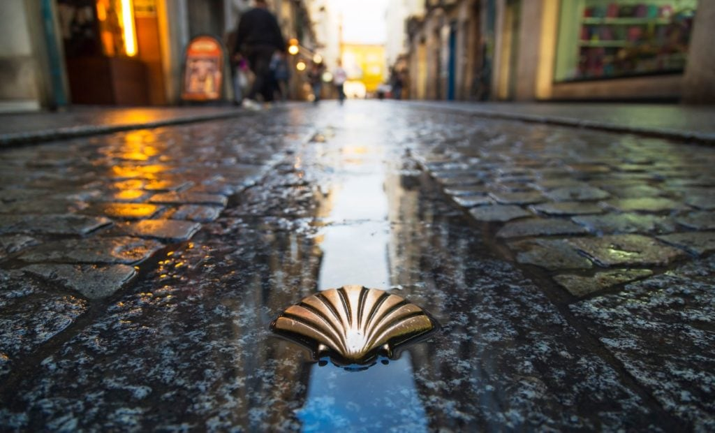The Camino Shell on a rainy street in Spain